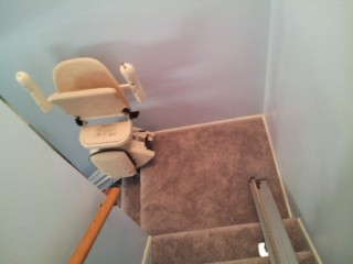 Two stairlifts on a split landing staircase